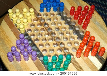 Chinese checkers board game displayed indoors for fun and skill.