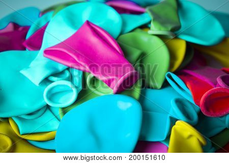 Group of deflated balloons of various colors