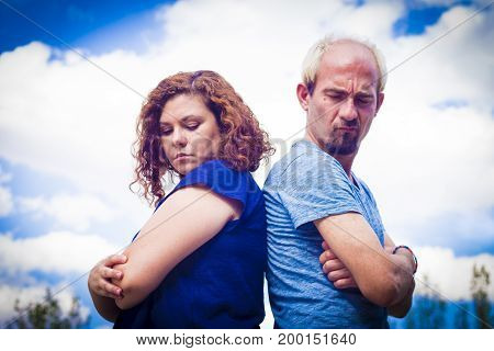 Couple in negative attitude angry transmitting emotional tension
