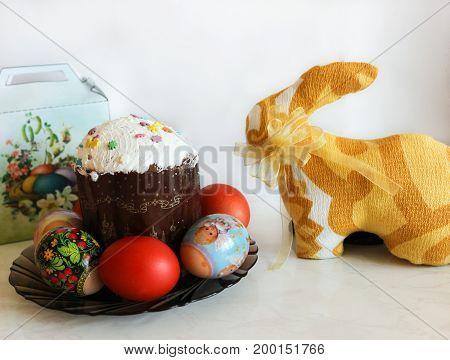 Easter rabbit, festive Easter cake and eggs