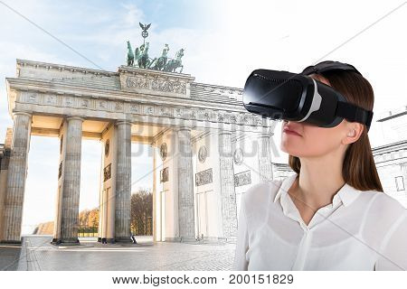 Close-up Of A Young Woman Wearing Virtual Reality Glasses In Front Of Brandenburg Gate