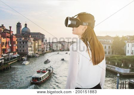 Rear View Of A Woman Wearing Virtual Reality Glasses At Italy