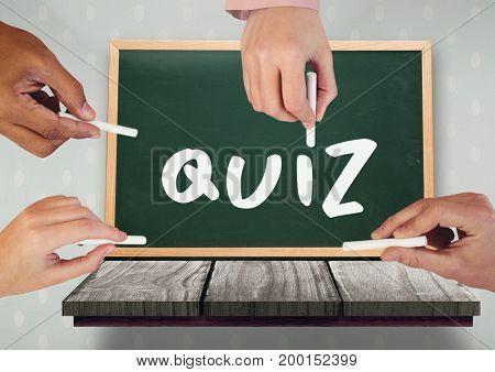 Digital composite of Hands writing quiz on blackboard