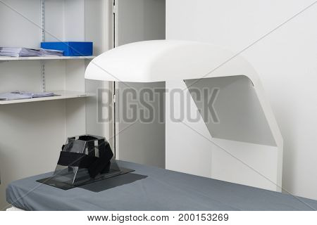 X-Ray Machine Over Bed At Clinic