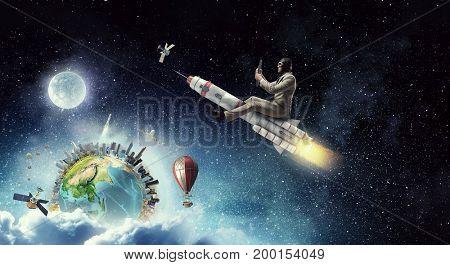 Aviator riding rocket. Mixed media . Mixed media