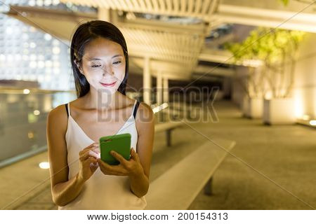 Young woman use of mobile phone in the city