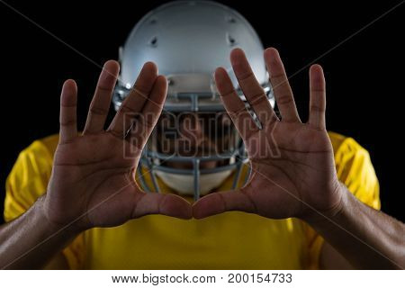 Close-up of American football player showing hand gestures