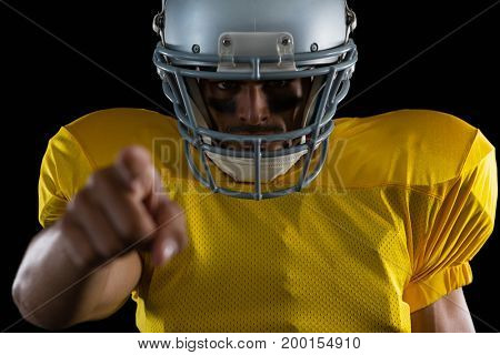 Portrait of American football player pointing with one hand