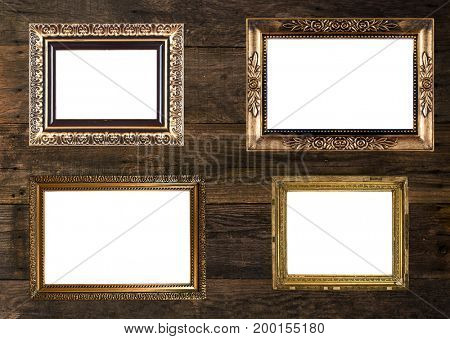 Group of Old Gold Picture Frames on wooden wall