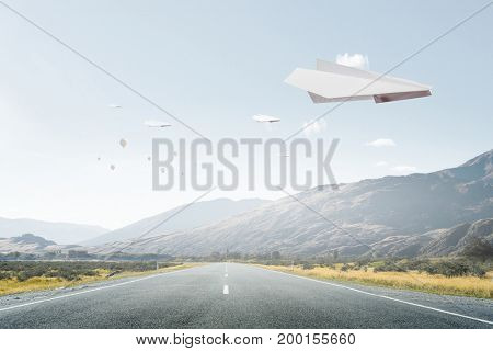 Origami plane flying in sky. Mixed media . Mixed media