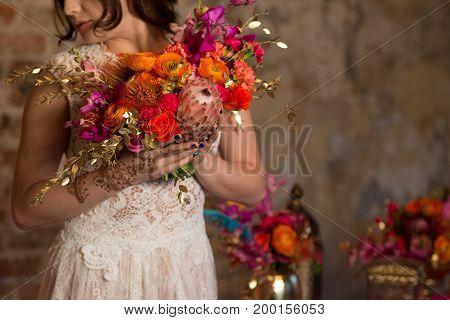 woman in wedding dress holding beutiful bouqet