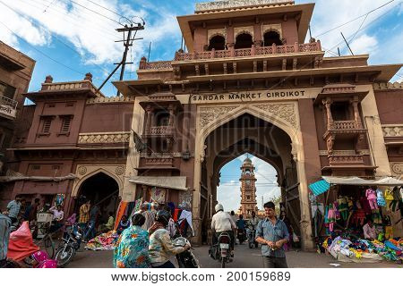 JODHPUR RAJASTHAN INDIA - MARCH 04 2016: Wide angle picture of Sadar Market Gate in Jodhpur the blue city of Rajasthan in India.