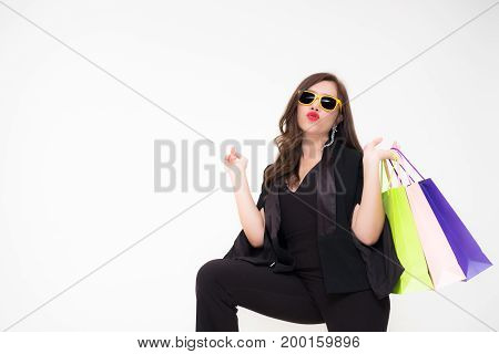 Beautiful young Asian woman holding bags from a recent shopping trip