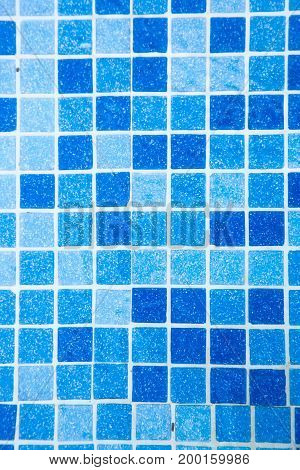 Mosaic of the swimming pool in shades of blue.