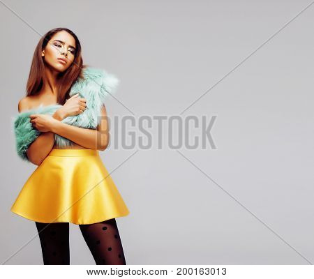 young pretty african-american woman posing in fashion clothers emotional, lifestyle people concept close up