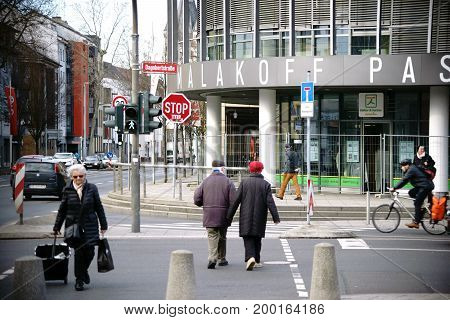 MAINZ, GERMANY - FEBRUARY 23: The intersection with traffic and passers-by in front of the modern building of the Malakoff Passage an office and shopping center on February 23, 2017 in Mainz.