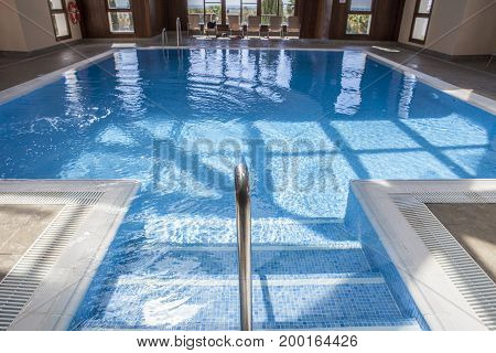 Spa luxury swimming pool with wooden structure. This facilities are part of a hotel