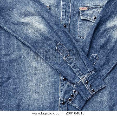 Close up blue denim shirt texture background