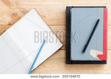 pencil and pen put on open notebook use for texts display