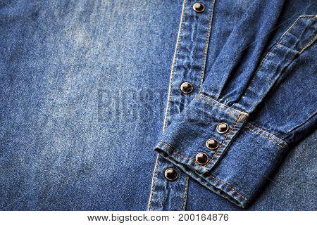 Close up old denim jeans shirt texture background