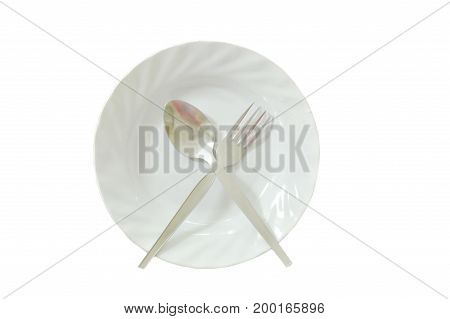 spoon and fork crossing on dish in white background