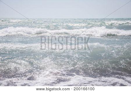 Sea waves at the coastal line