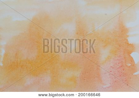 Orange watercolor abstraction background. Gradient watercolor. Technique of wet watercolor. Element of design.