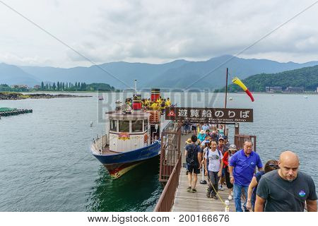 YAMANASHI JAPAN - July 24 2017 Tourists with Sightseeing boat in the lake of Kawaguchi