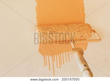 Closeup of Painting wall with brush roller
