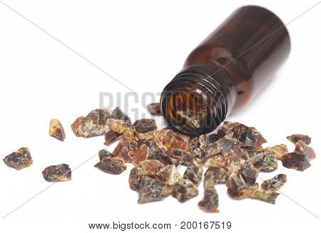 Frankincense dhoop with essential oil over white background