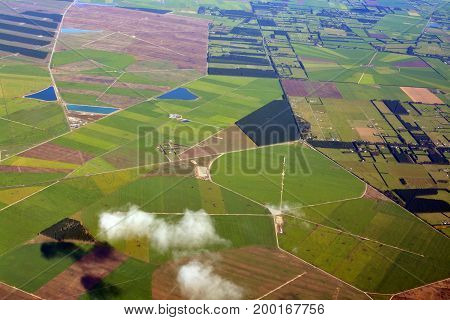 Closeup aerial view of Canterbury Plains as the mist clears on an Autumn morning New Zealand. In the background are the Southern Alps.