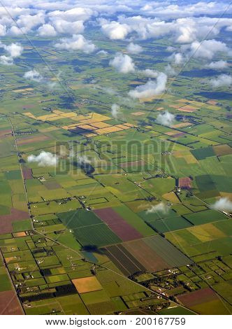 Canterbury Plains aerial view as the mist clears on an Autumn morning New Zealand. In the background are the Southern Alps.