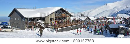 Mount Hutt New Zealand - July 30 2017: Panoramic view of the Mount Hutt Ski Field Huber's Restaurant at Lunch Time. Skiers prepare to ride on the Chairlift outside the restaurant Canterbury New Zealand.