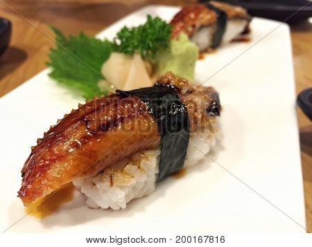 Traditional Japanese food, Eel (unagi) Nigiri Sushi or Unagi Kabayaki on wooden background