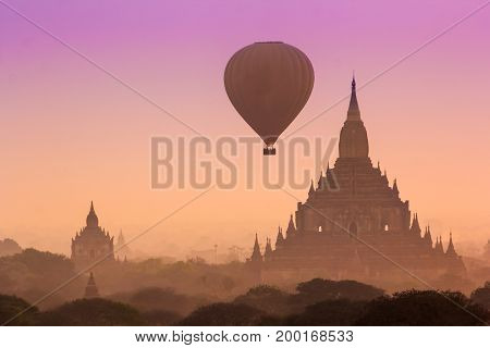 Hot air balloon over misty morning around Temple in Bagan Myanmar