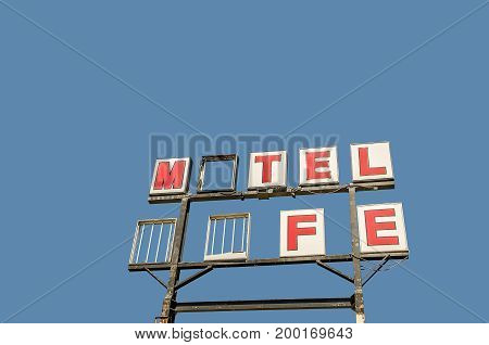 Former motel and cafe sign on Route 66 is now missing letters and neon tubing