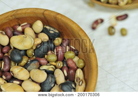 Soy beans, Red beans, black beans, Peanut, and green beans with the health benefits of whole grain. Bean background