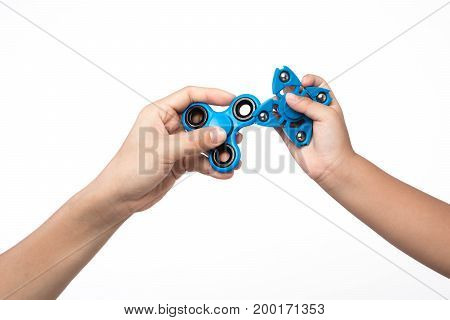 Two finger spinner stress anxiety relief toy on white background.