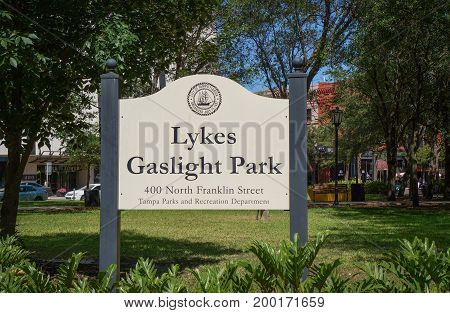 Signage of the Lykes Gaslight Park at lunchtime. Franklin Street, Downtown Tampa, Florida, United States, April 28, 2017