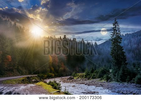 day and night time change concept over foggy forest and river. beautiful autumnal landscape in mountains with sun and full moon