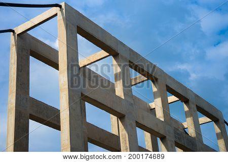 Concrete under construction of suspension bridge at the construction site with blue sky background.