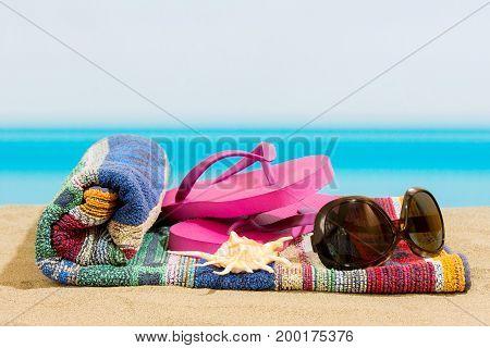 Flip flops on the beach, sea in summer
