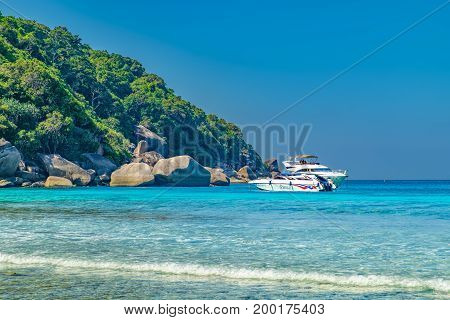 Phang Nga, Thailand - January 4, 2016: Water excursion to the Koh Similan No.8 Island in Similan National park, Andaman Sea, Thailand. Beautiful landscape with the rock tourist boats and mountain