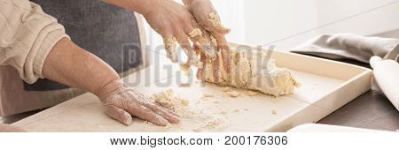 Grandmother And Granddaughter Kneading Dough