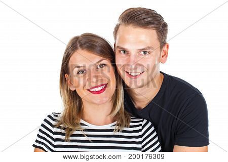 Portrait of a happy young couple smiling at the camera on isolated background wearing casual outfit