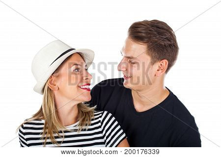 Picture of a happy young couple with casual outfit posing on isolated background