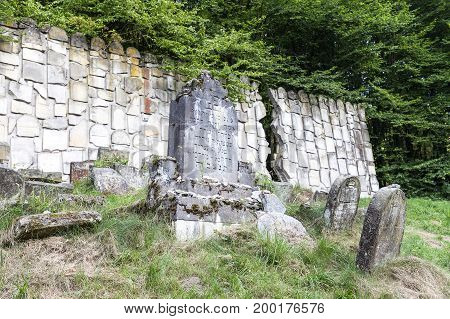 KAZIMIERZ DOLNY - POLAND AUGUST 9 2017: Jewish cemetery in Kazimierz Dolny Czerniawy Poland. Symbolic Wailing Wall built of tombstones destroyed by German Nazis during World War II.