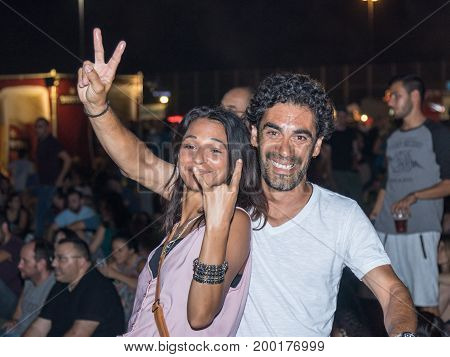 Haifa Israel August 16 2017 : A young couple happily posing at the traditional annual beer festival in Haifa Israel
