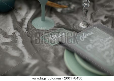 decorate Wedding plate with beautiful winter flowers and snow