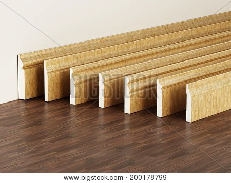 Baseboards With Various Profiles Standing On Hardwood Surface. 3D Illustration